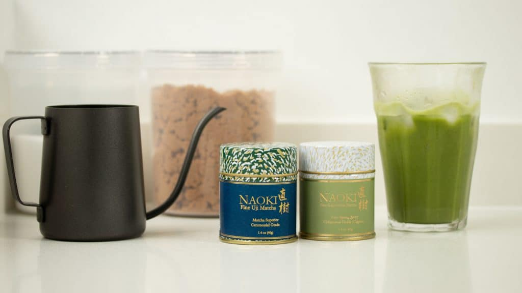 Naoki's Superior Ceremonial Matcha and Organic Ceremonial Matcha blends for matcha latte, and a glass of iced matcha latte