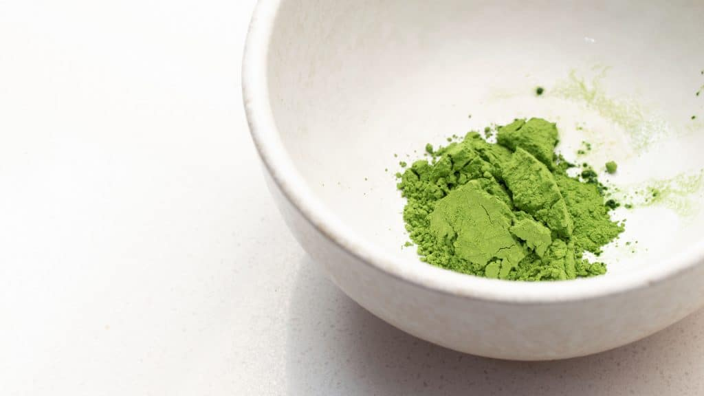 matcha powder in a white bowl