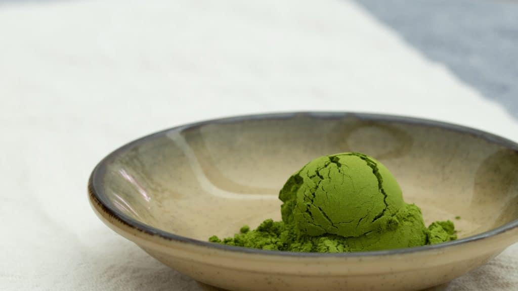 a heap of matcha powder on plate