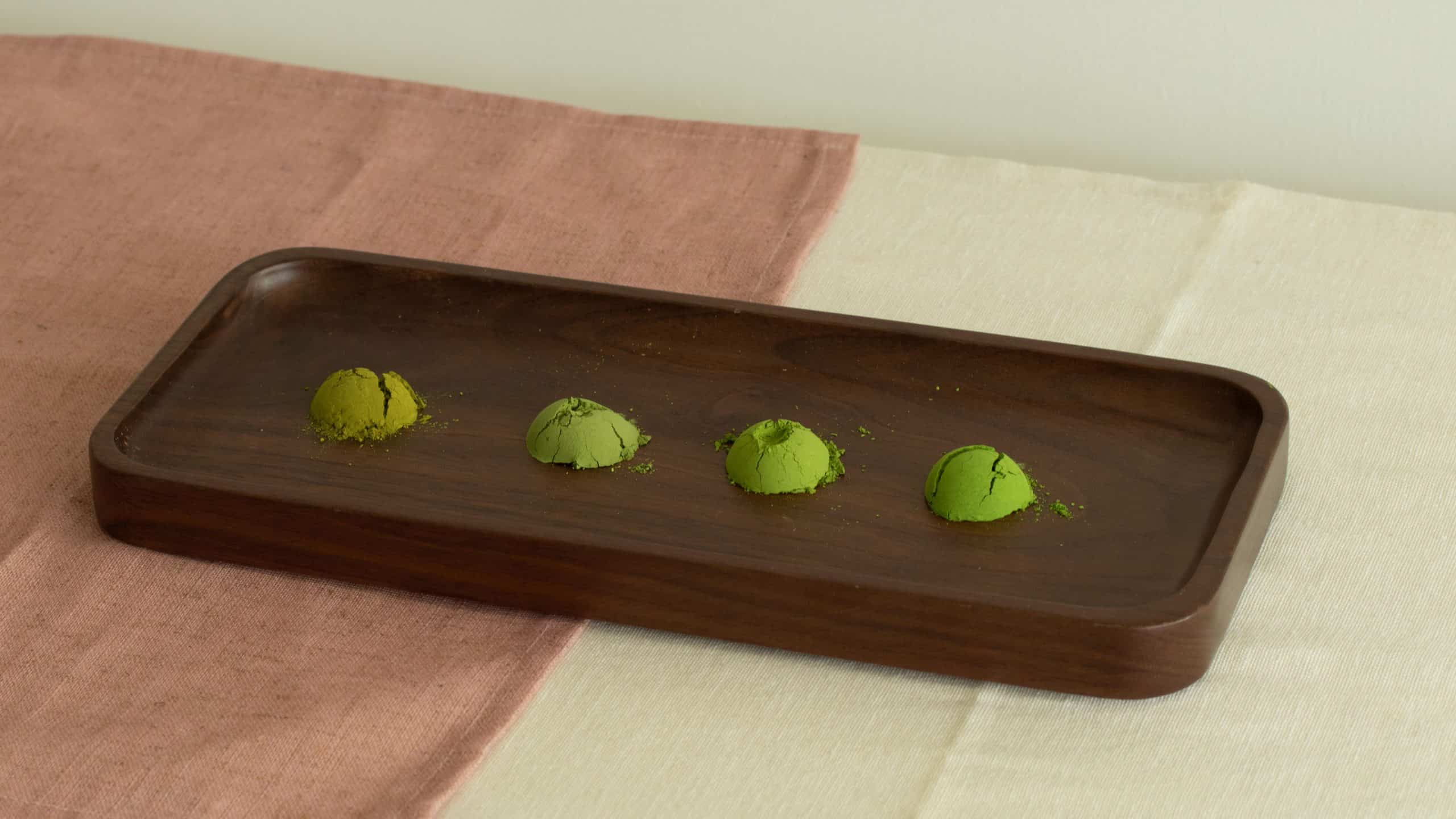 Four matcha powder on wooden tray for matcha grade comparison