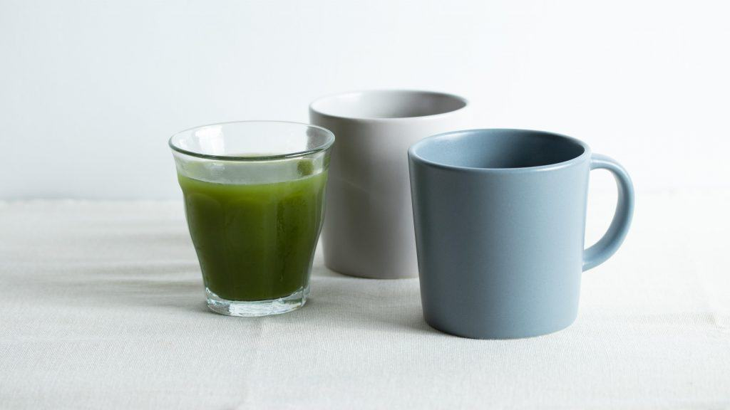 Japanese matcha tea in a glass with a blue and grey mug
