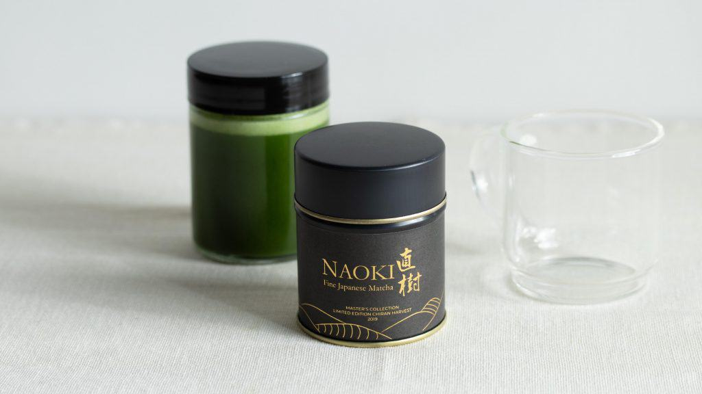 Chiran Harvest Ceremonial Matcha blend with an empty cup and a small jar of matcha shot