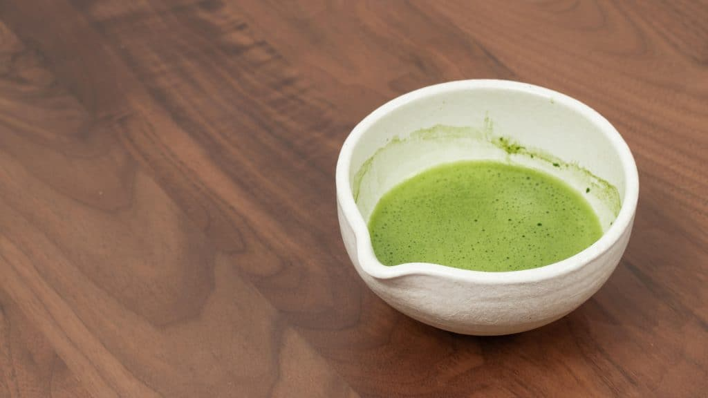 Usucha Japanese tea in a white bowl on a wooden table