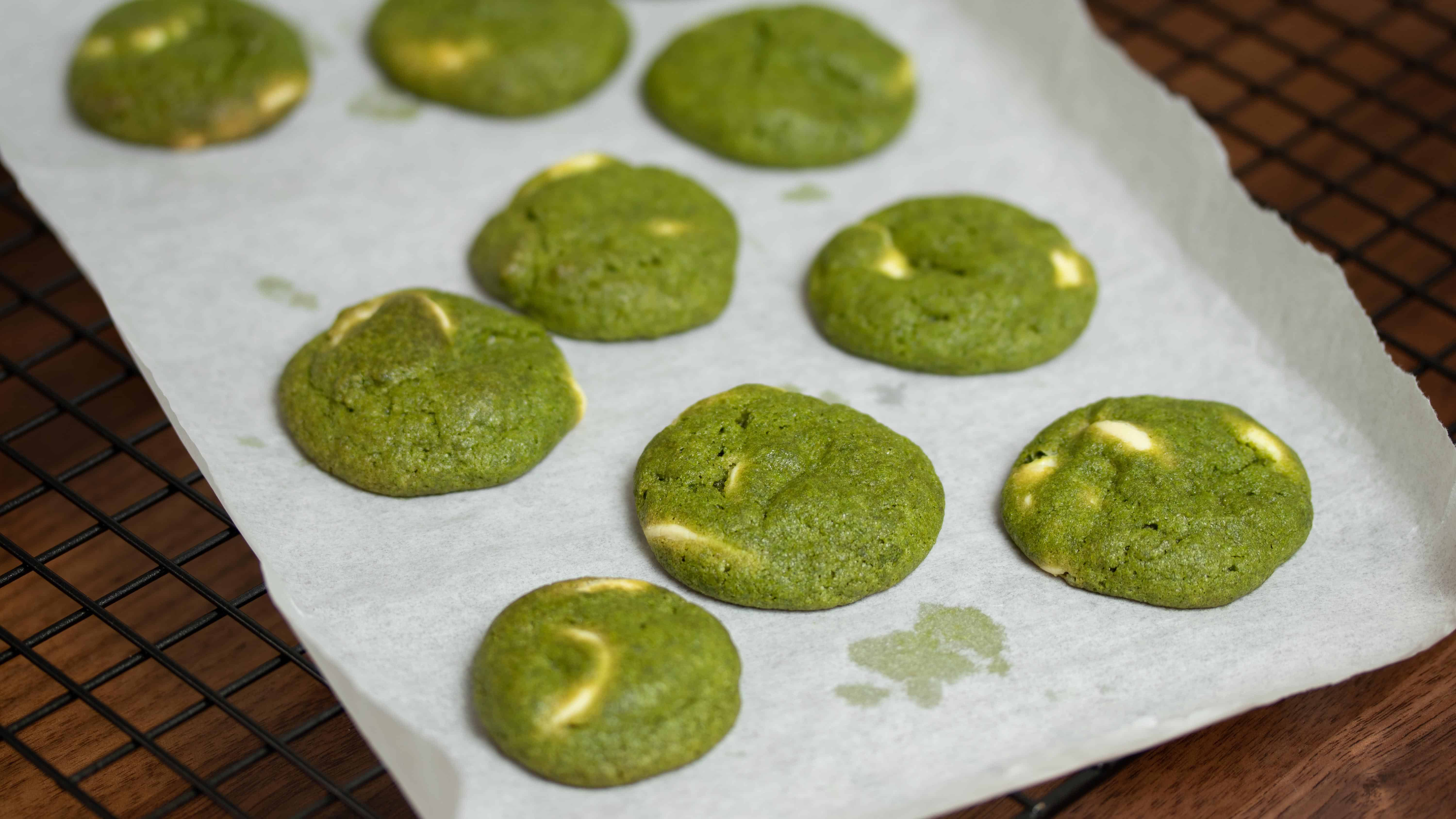 bright green matcha green tea white chocolate chips cookies on tray after baking