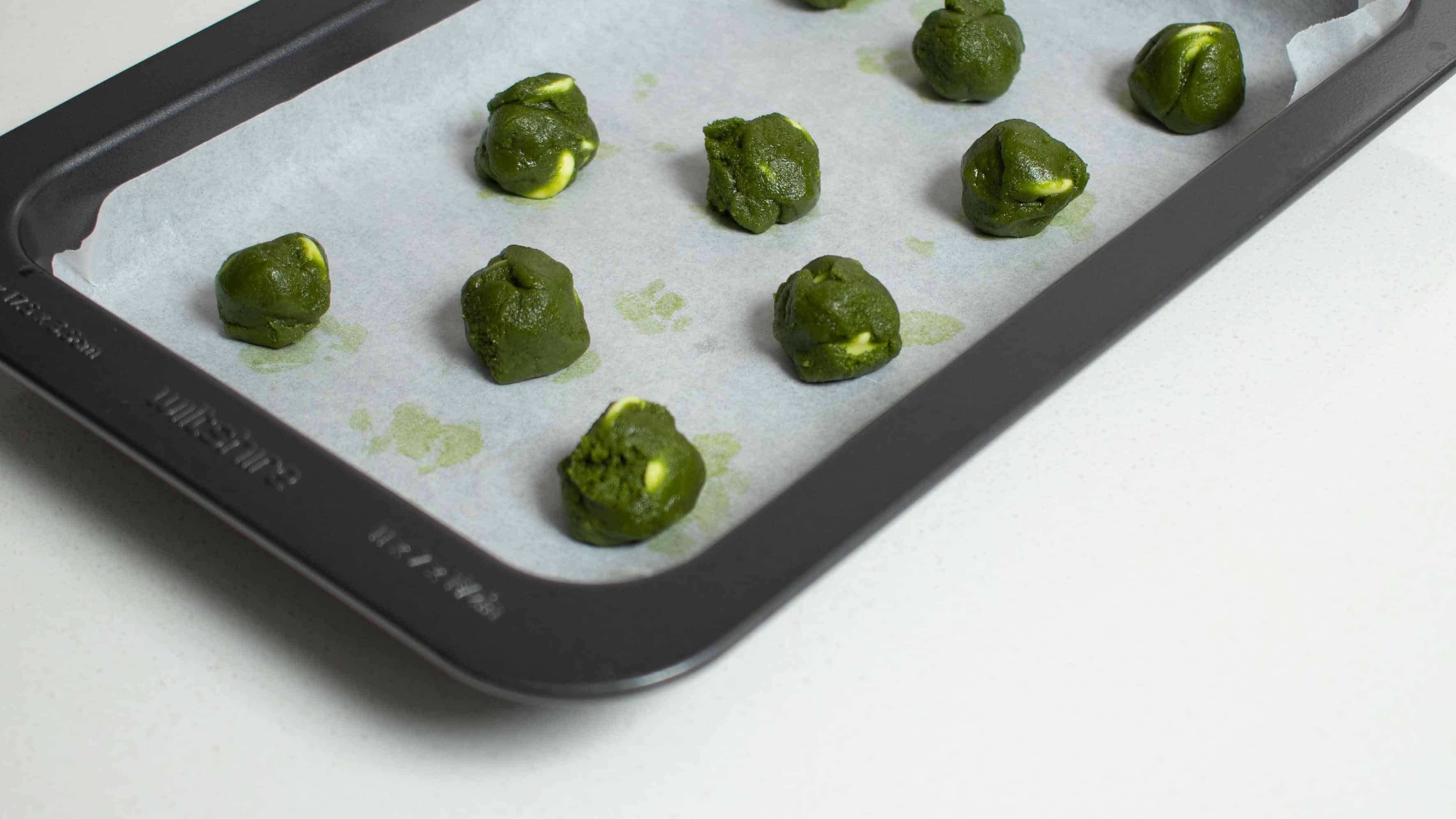 Matcha green tea cookie dough on tray for baking