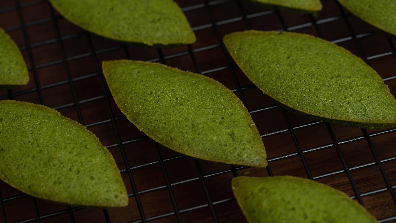closeup on freshly baked matcha financiers