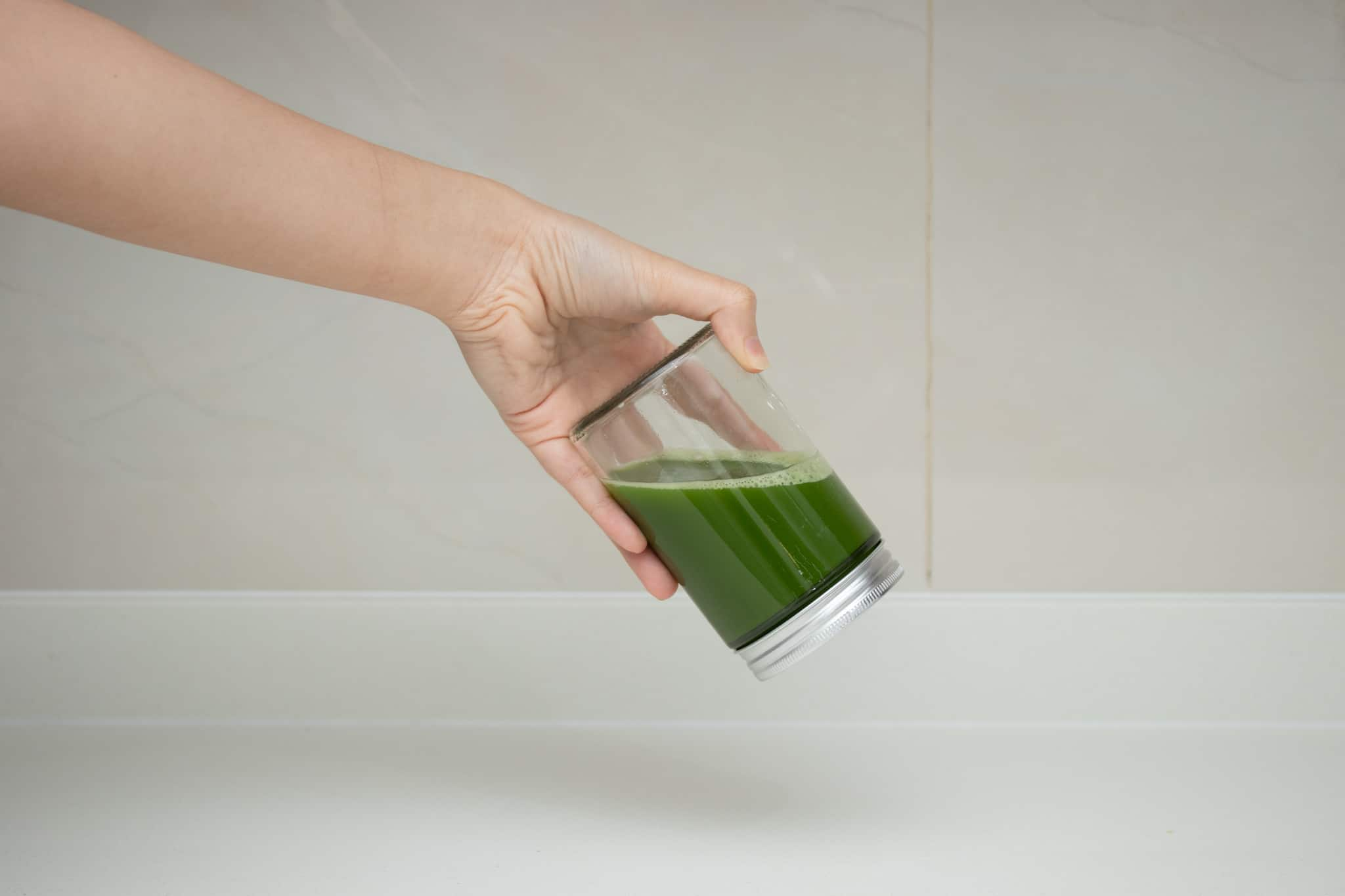 making matcha tea by shaking in a bottle